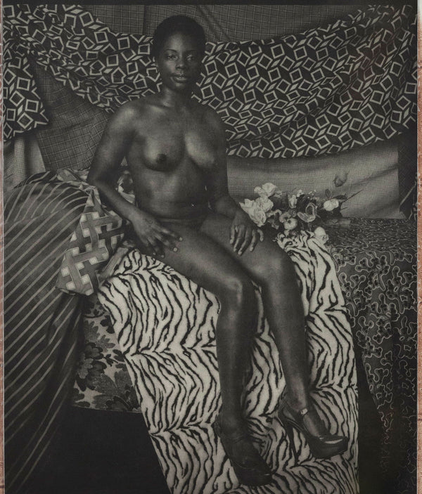Mickalene Thomas portrait of marie sitting in black and white