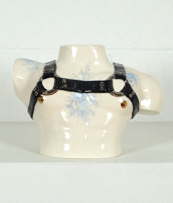 This is a ceramic vase for sale from Caviar20. Made by Pansy Ass and represents a torso with a leather harness.