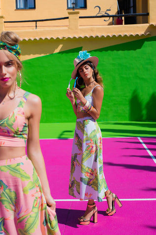 Dancing Leopard models on a pink and green tennis court