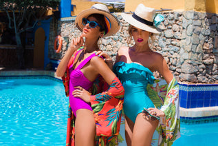 Dancing Leopard models wearing swimsuits by pool
