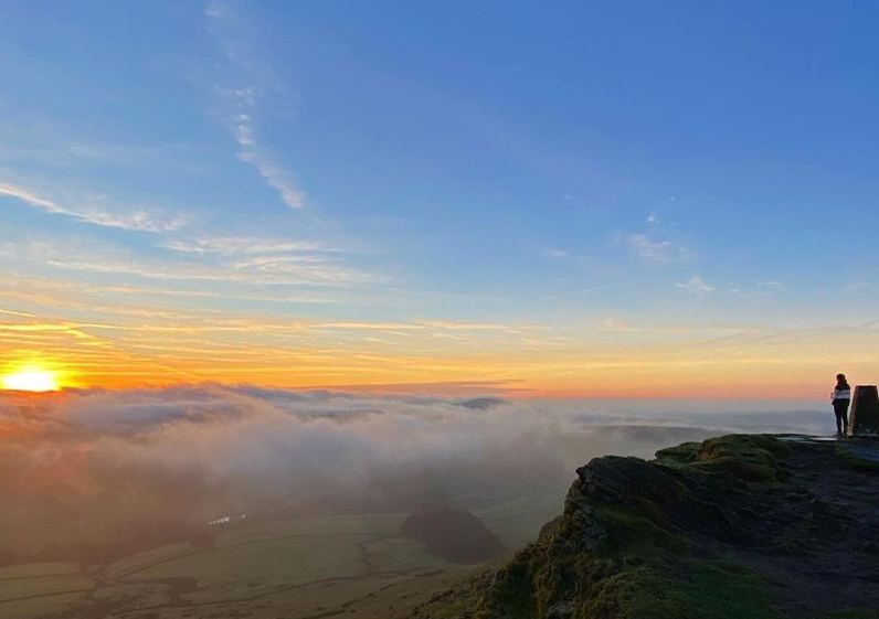view from Shutlingsloe, Peak District, showing sun above the clouds
