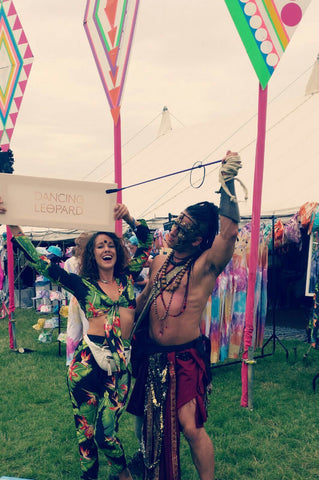 couple holding Dancing Leopard sign at Secret Garden Party