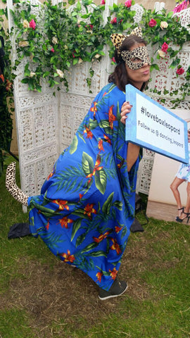 lady holding #loveboxleopard sign at Lovebox