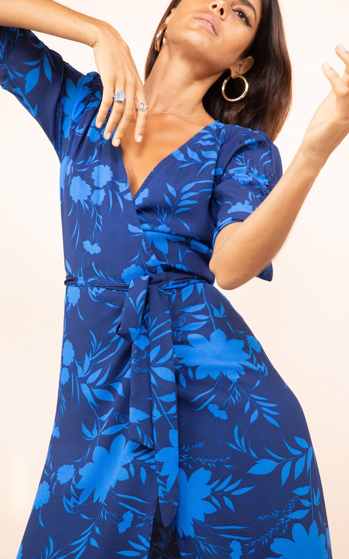 Dancing Leopard model faces forward wearing Olivera Midi Dress in blue floral print