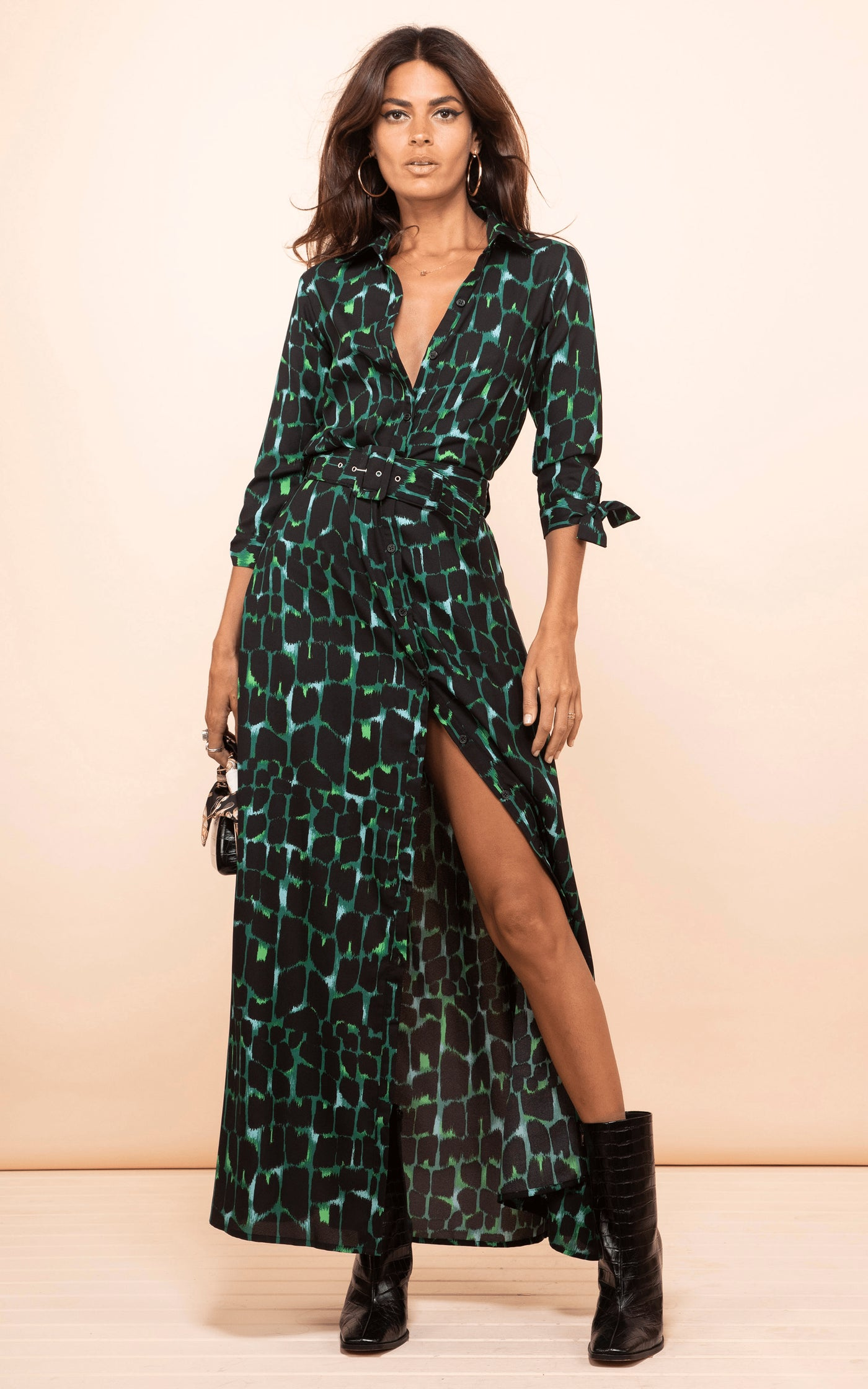 Front-facing model wears Dove Dress in green alligator print by Dancing Leopard with boots