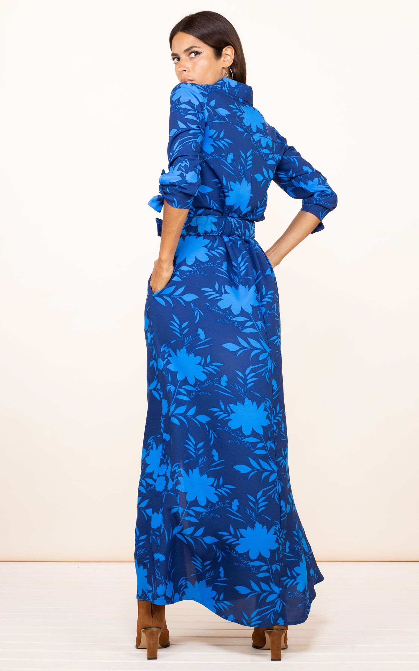 Dancing Leopard model faces backwards wearing Dove Dress in Dark Blue Silhouette Ground