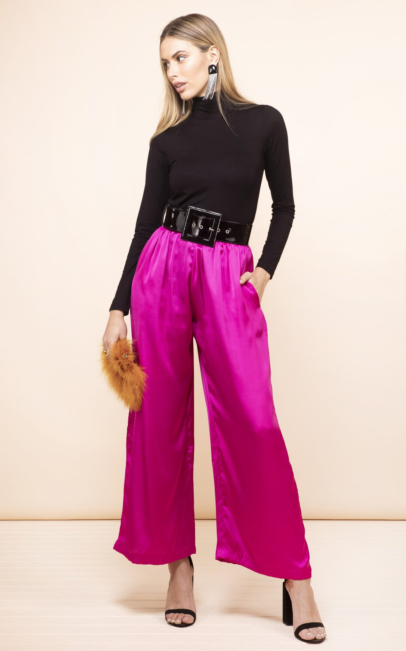 Front-facing model looking left wearing Chinchilla Trousers in magenta pink by Dancing Leopard