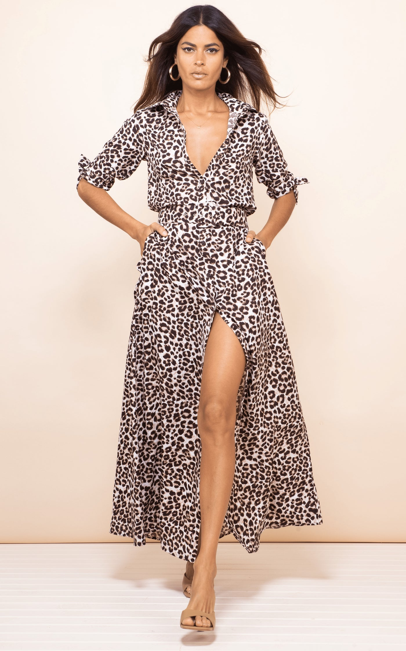 Front-facing brunette model wears Dove Dress in leopard print by Dancing Leopard with heels