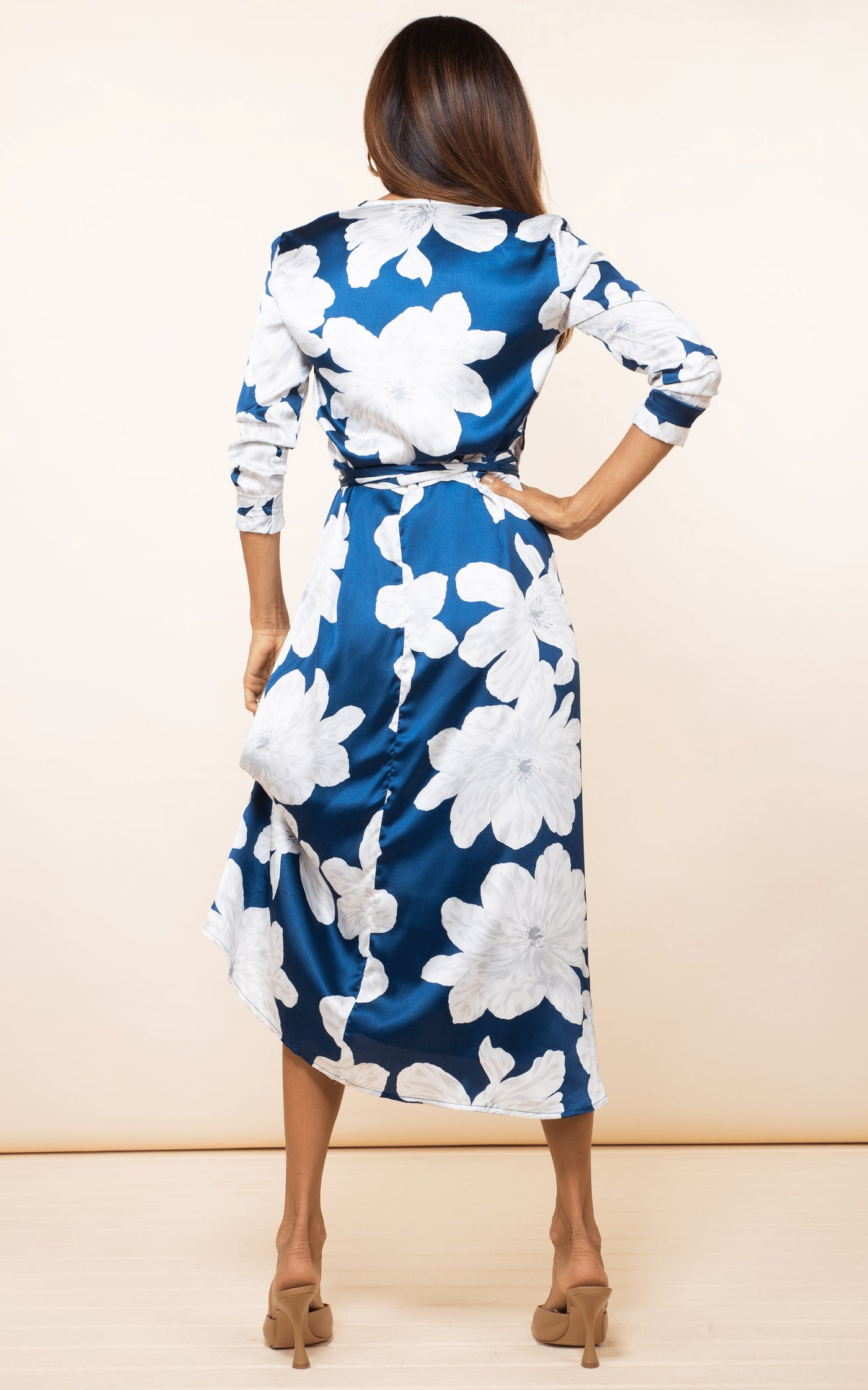 Backward-facing model wears Dancing Leopard Yondal Dress in navy and white floral print