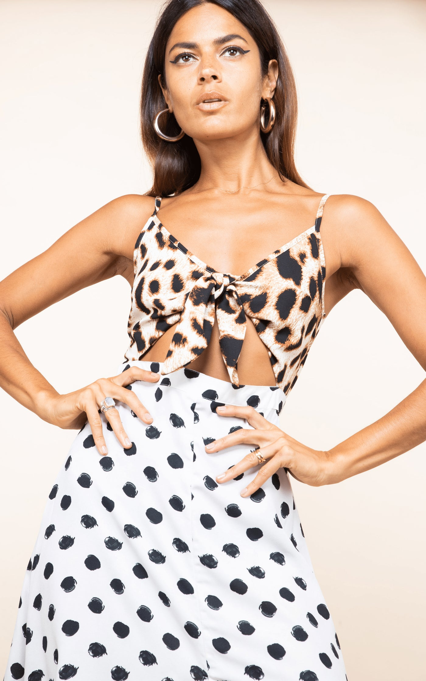 Forward-facing model with hands on hips wears Dancing Leopard Malibu Dress in mixed print