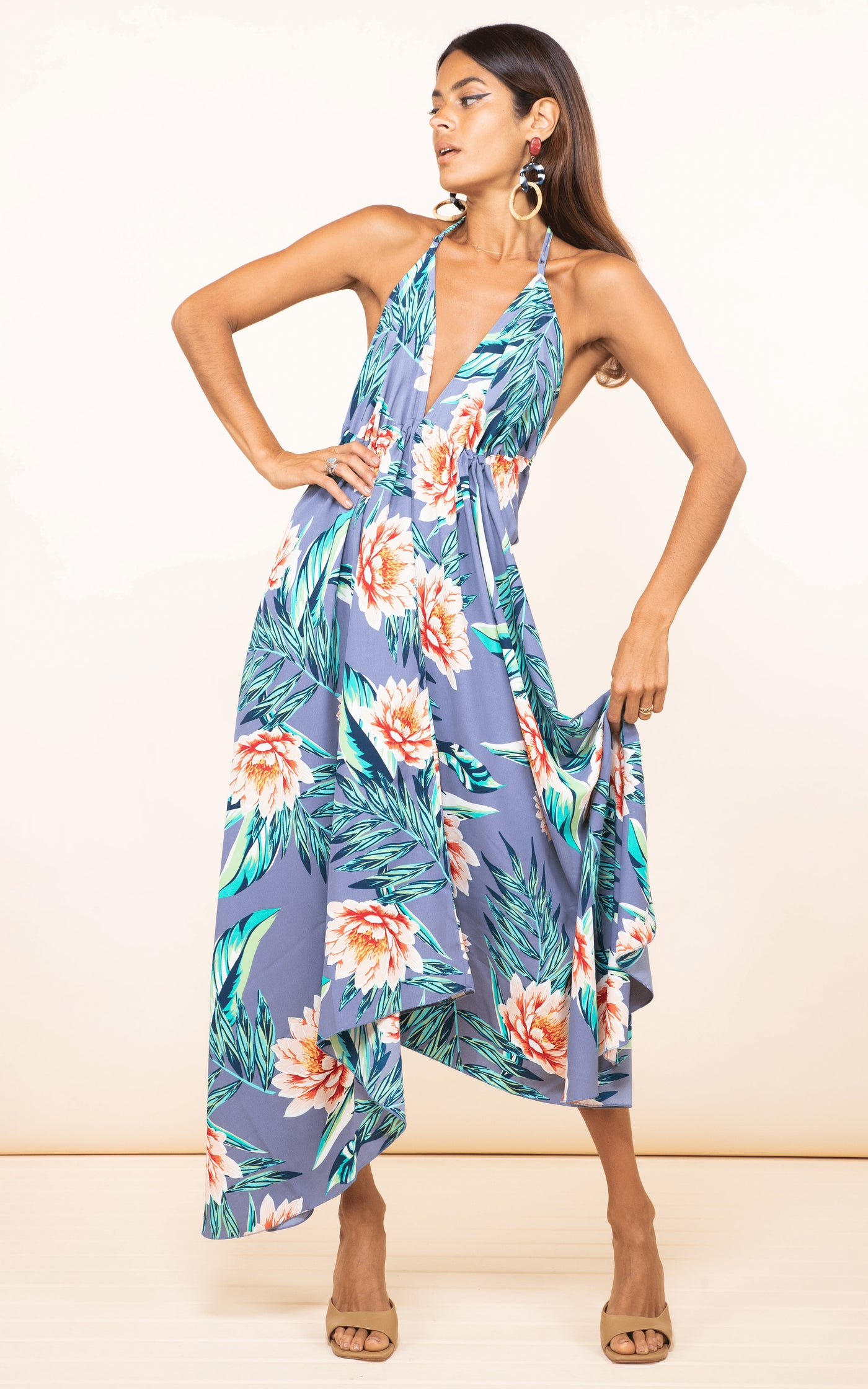 Dancing Leopard model with hands on hips wearing Boho Maxi Dress in grey floral tropical print