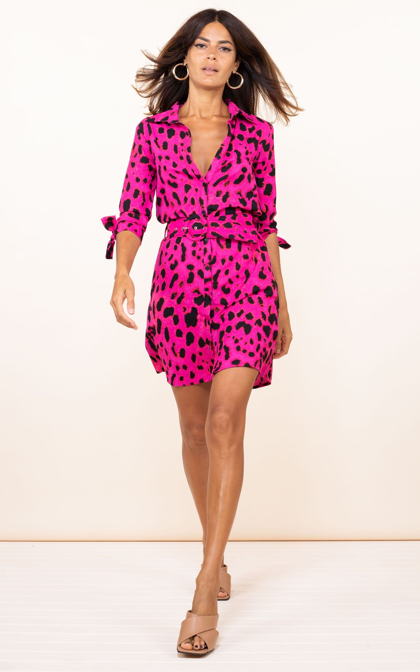 Dancing Leopard model walks forward wearing Jonah Mini Shirt Dress in pink leopard print with heels
