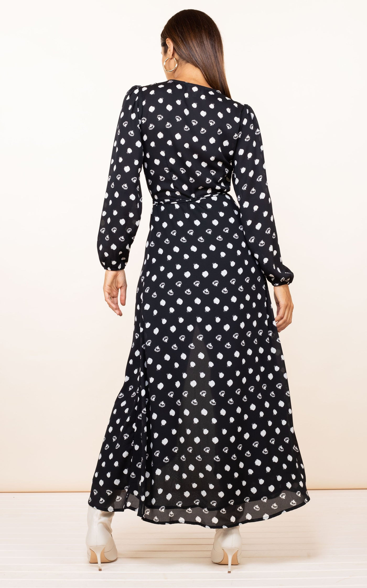 Model faces backwards wearing Dancing Leopard Jagger Dress in painted dot with boots