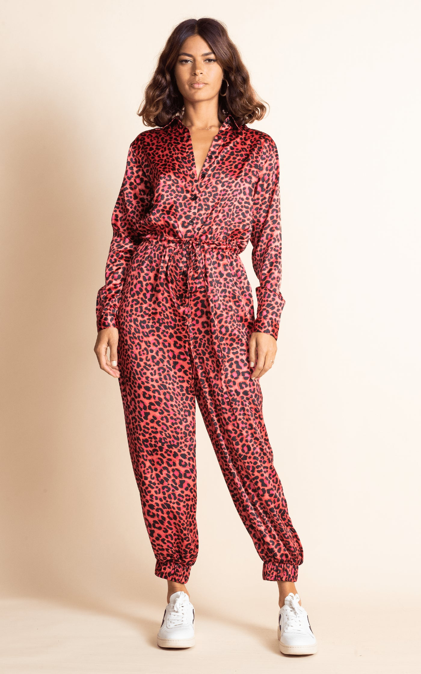Dancing Leopard model facing backwards wearing Sami Jumpsuit in Ruby Red Leopard