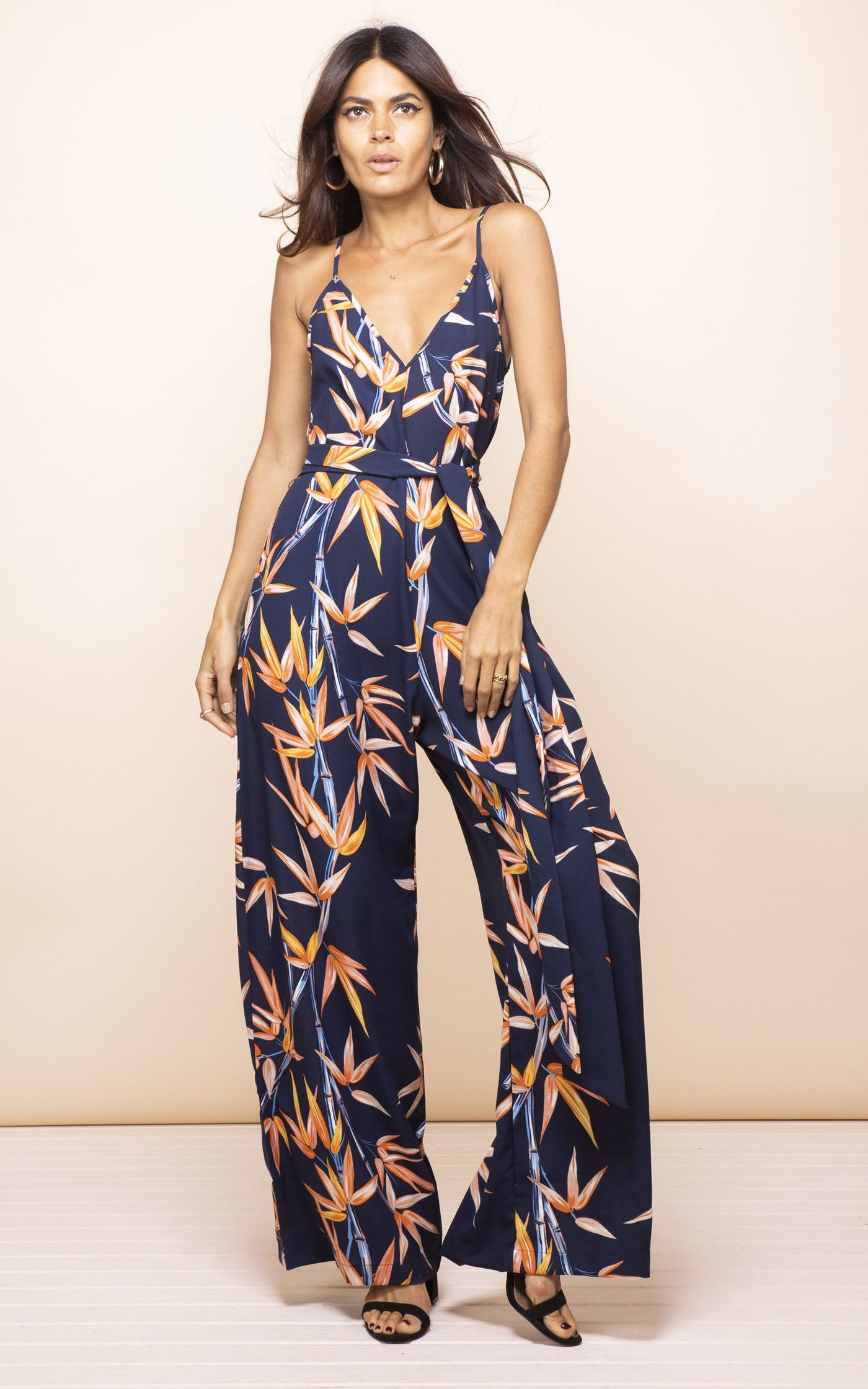 Dancing Leopard model faces forward and looks up wearing Gabriella Jumpsuit in bamboo print