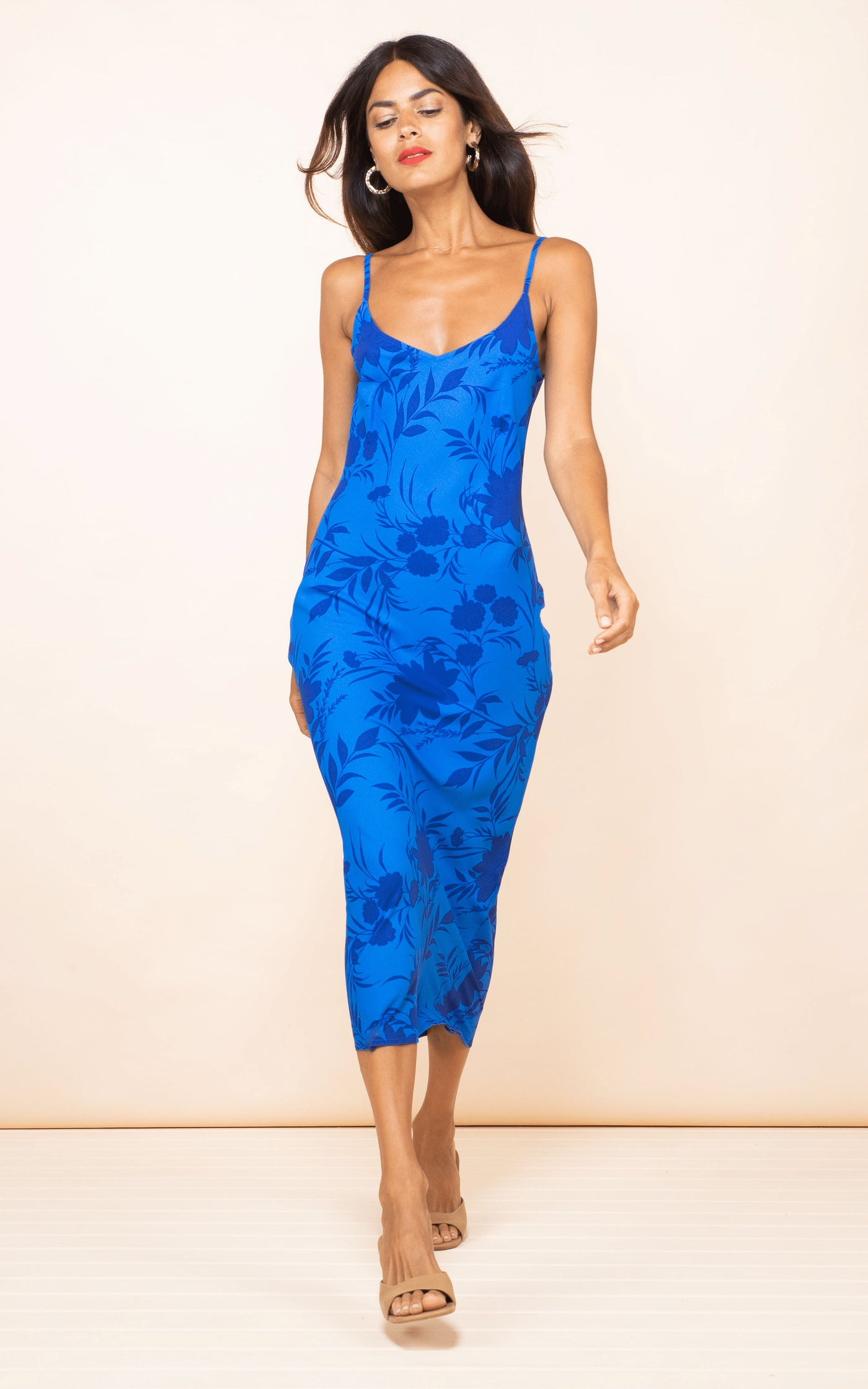 Dancing Leopard model walks forward wearing Sienna Midaxi Dress in blue floral print