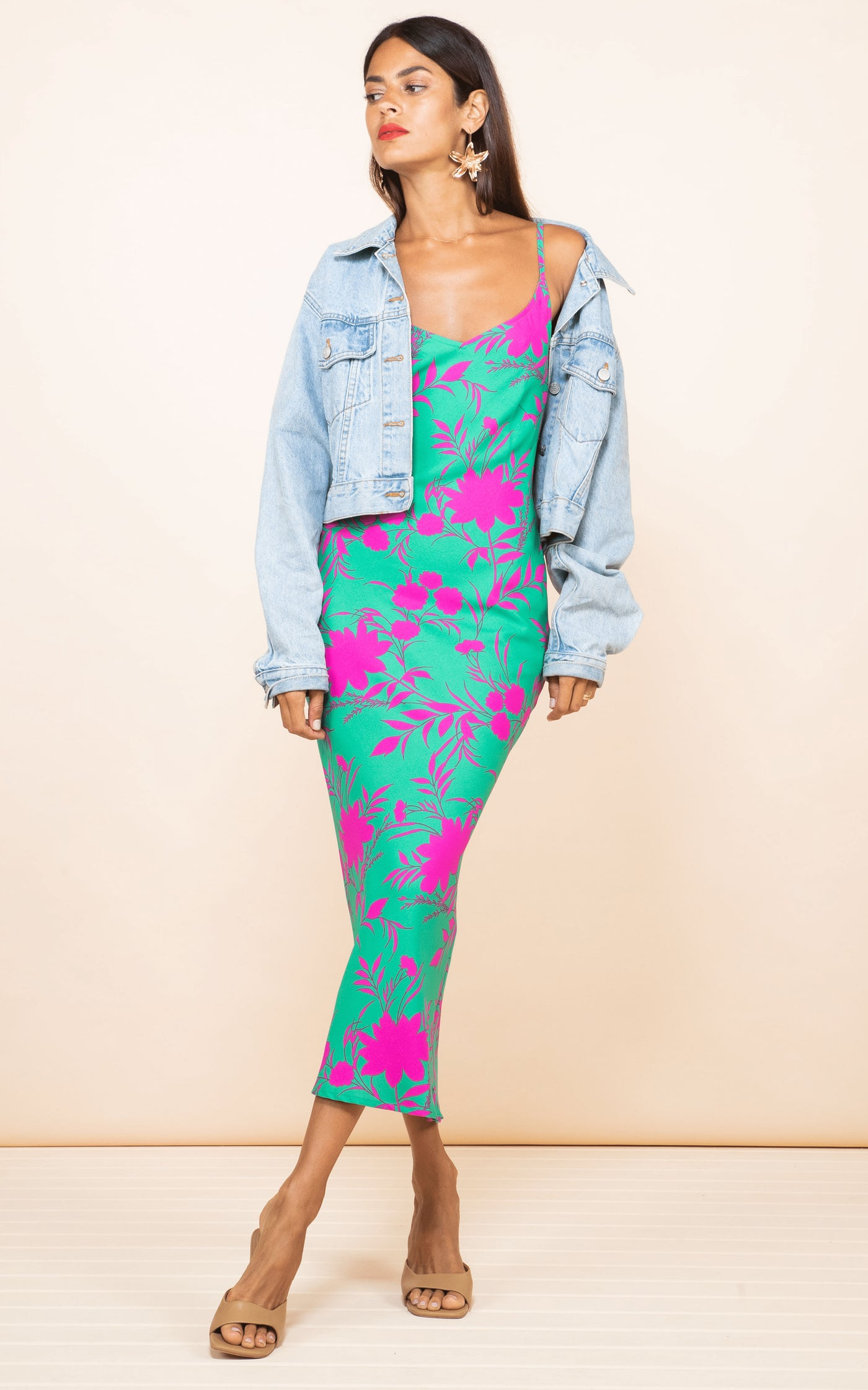 Front-facing model wears Sienna Midaxi Dress in Silhouette Pink on Green by Dancing Leopard styled with denim jacket