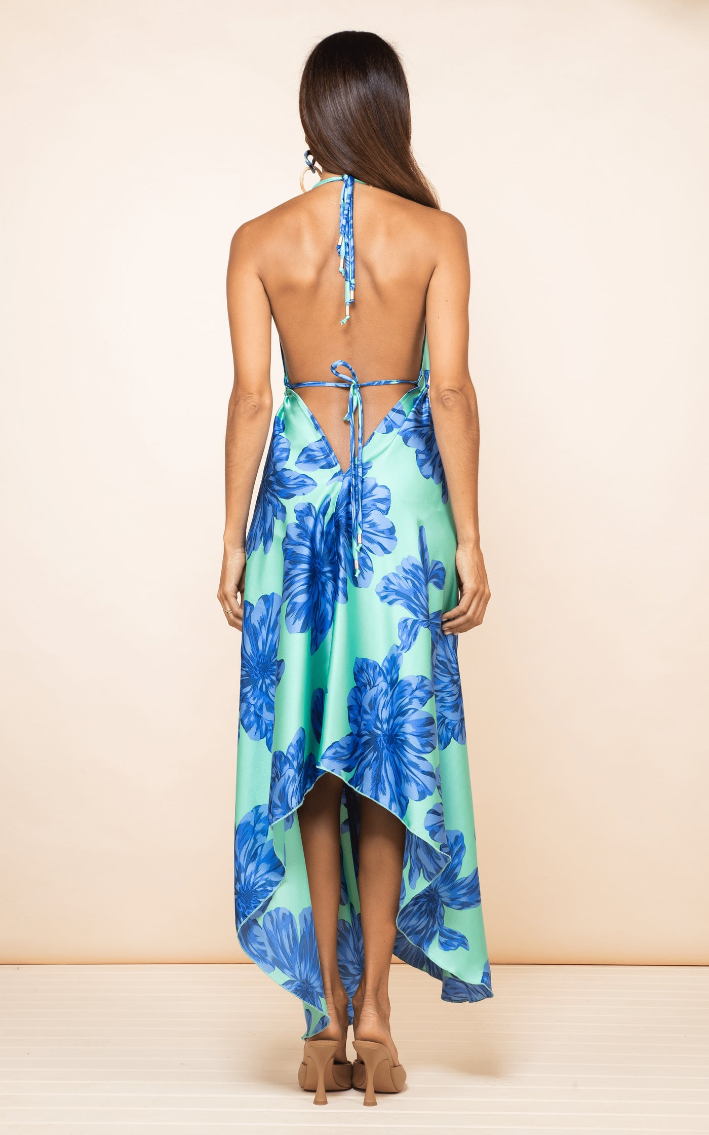 Backwards facing Dancing Leopard model with brown hair wears Boho Maxi Dress in Blue on Mint Bloom and earrings