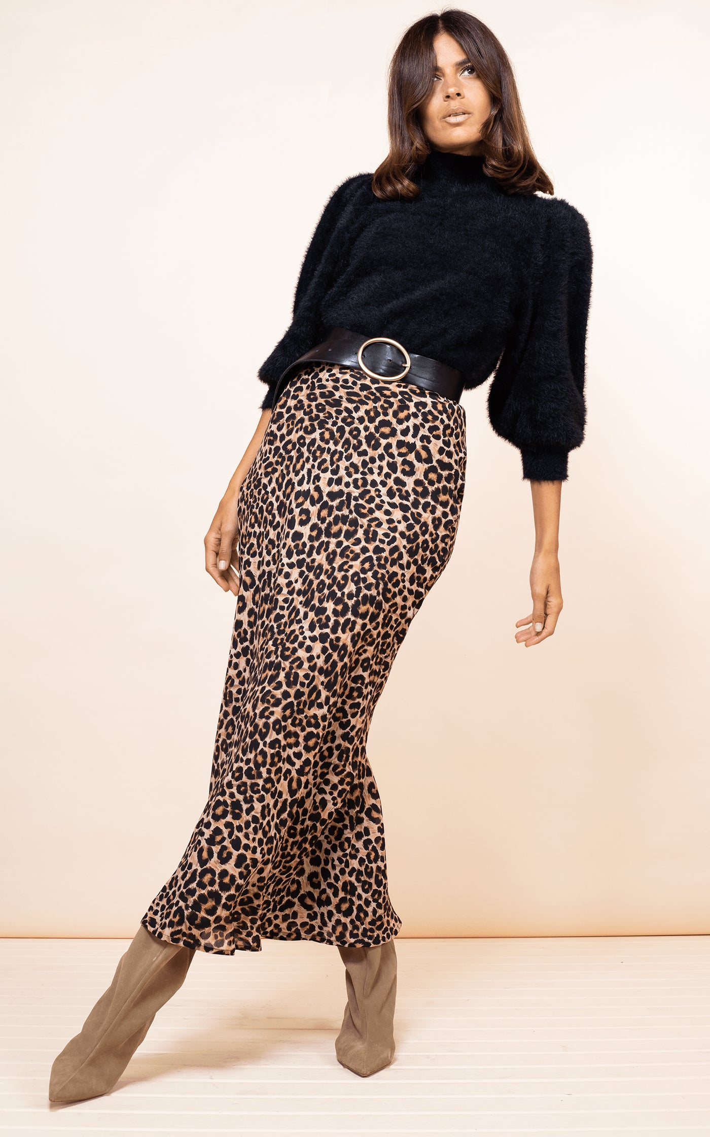 Dancing Leopard model faces forward wearing Sophie Skirt in Rich Leopard print with black fluffy jumper
