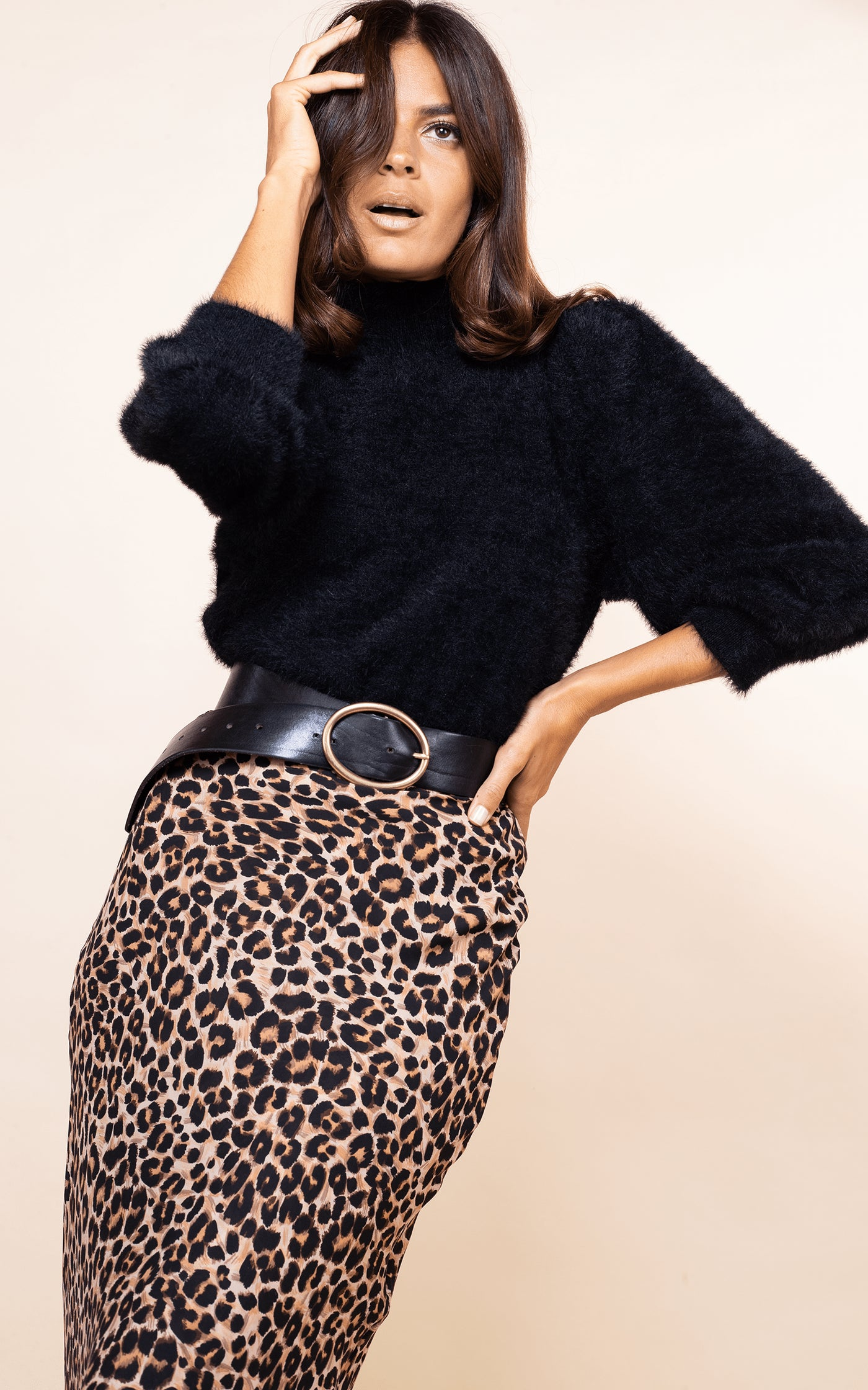Close-up of Dancing Leopard model facing forward wearing Sophie Skirt in Rich Leopard print with black fluffy jumper