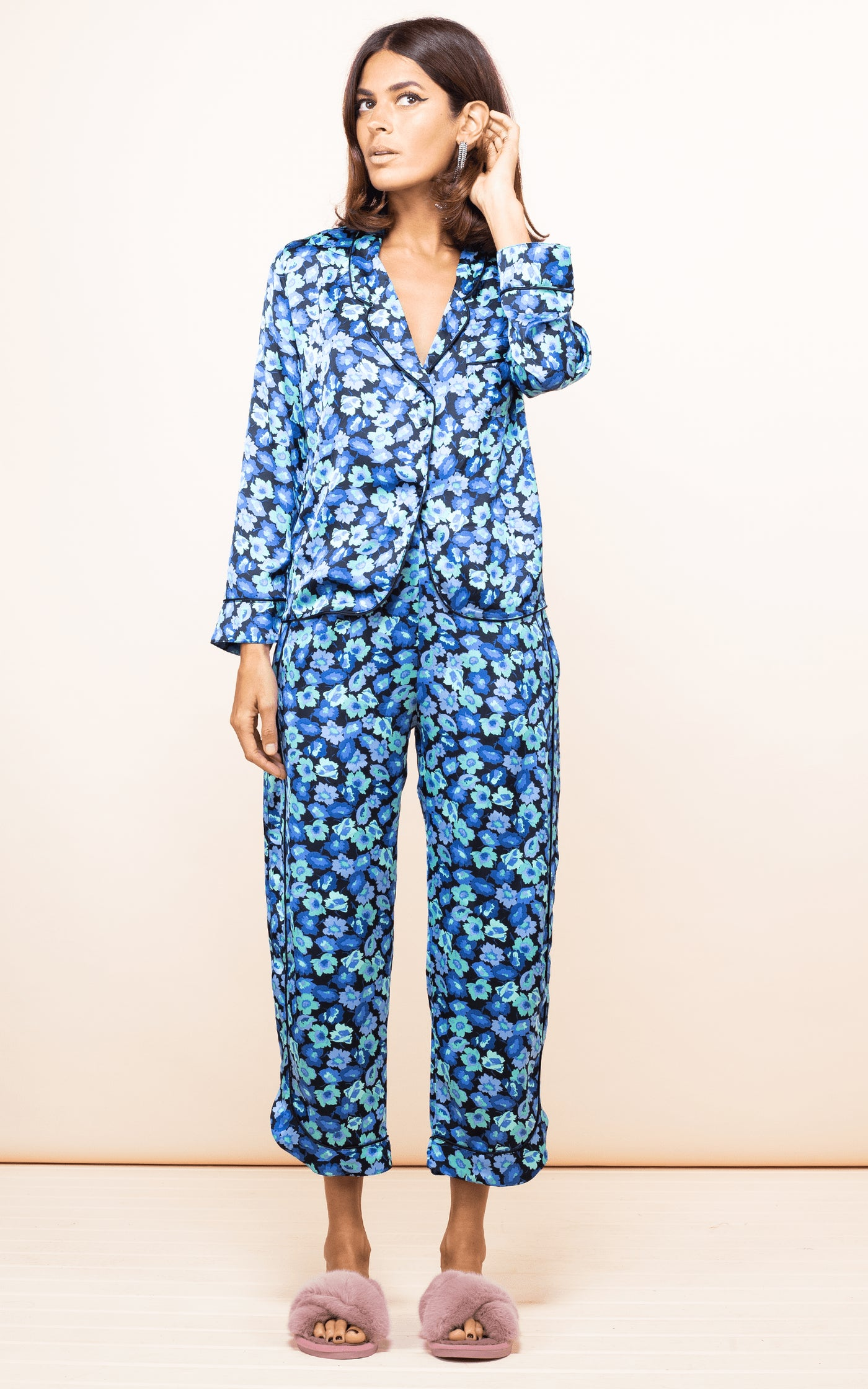 Dancing Leopard model faces forward wearing Enya PJ Set in 50s-inspired blue floral print with slippers