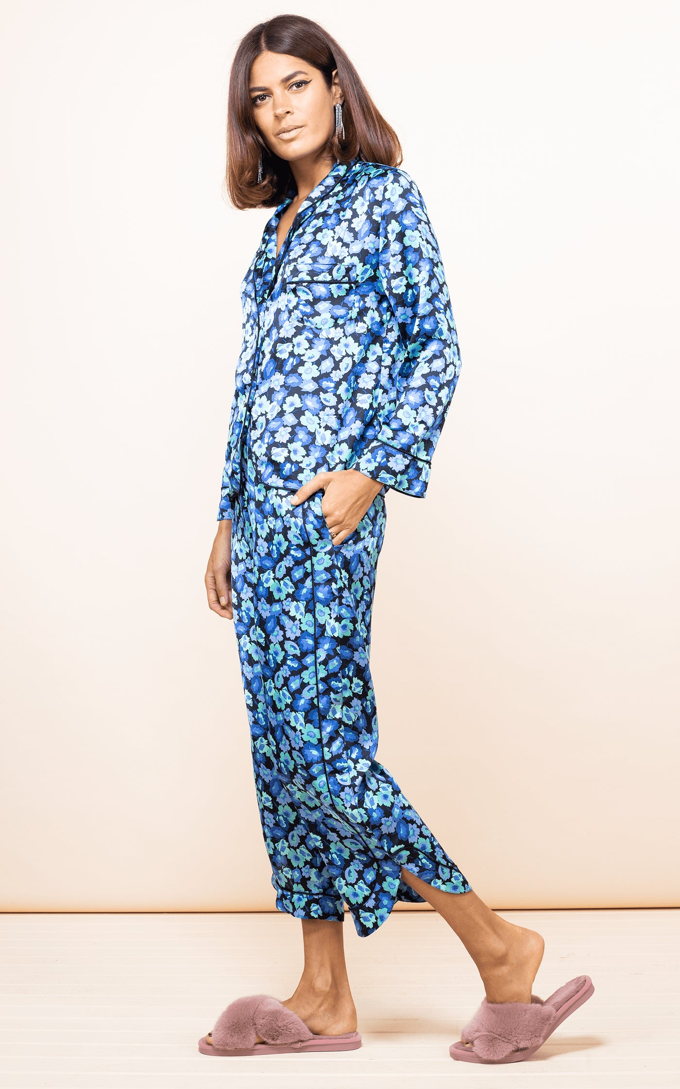 Dancing Leopard model walks forward wearing Enya PJ Set in 50s-inspired blue floral print with slippers
