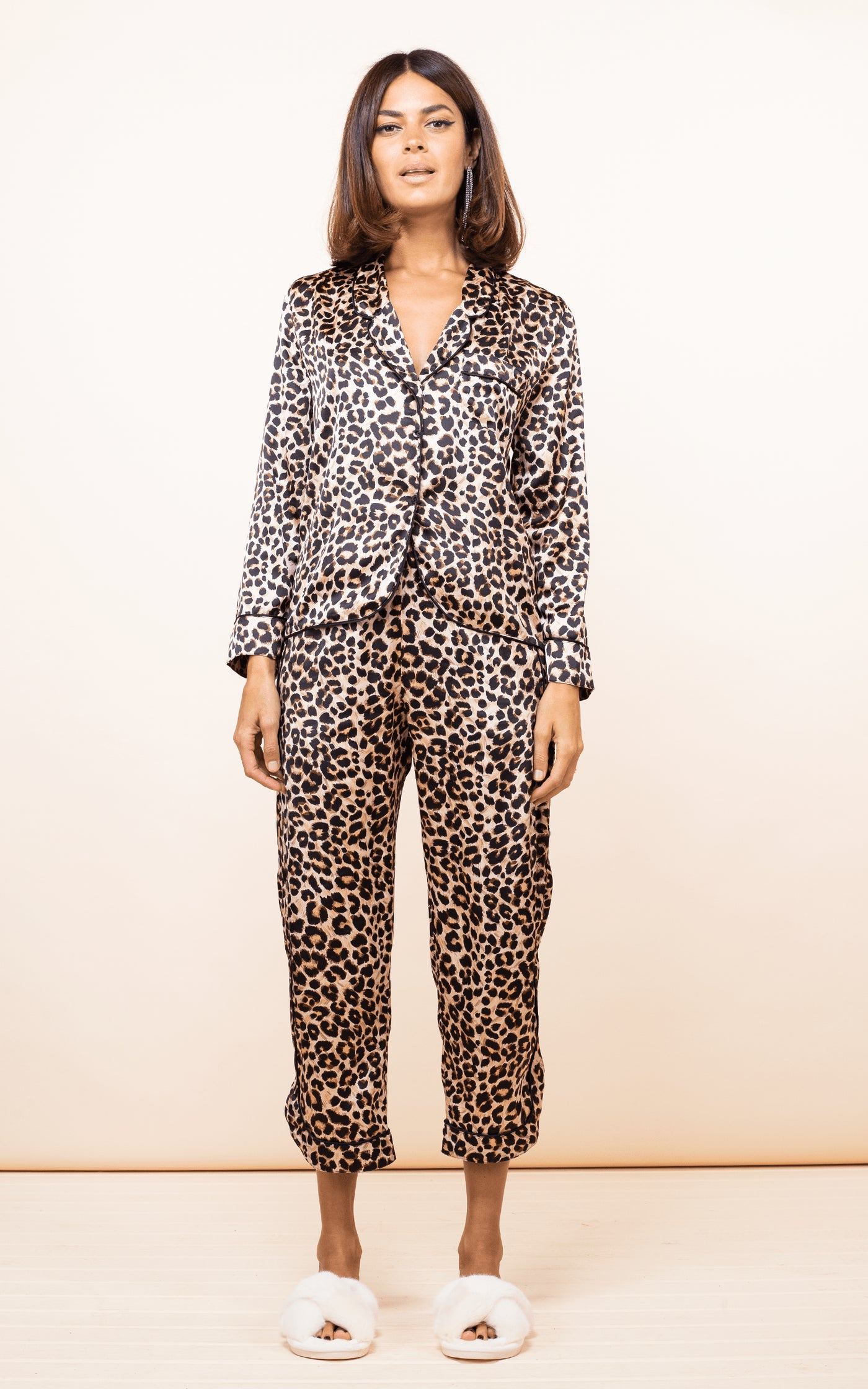 Dancing Leopard model faces forward wearing Enya PJ Set in Rich Leopard print with slippers
