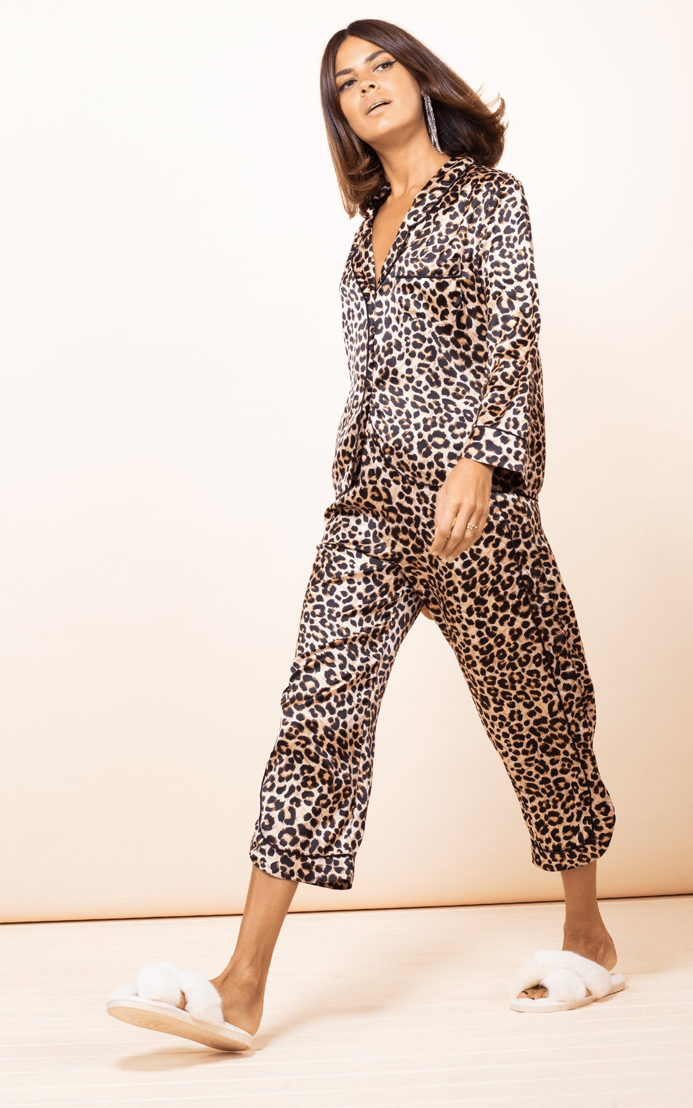 Dancing Leopard model strides forward wearing Enya PJ Set in Rich Leopard print and slippers