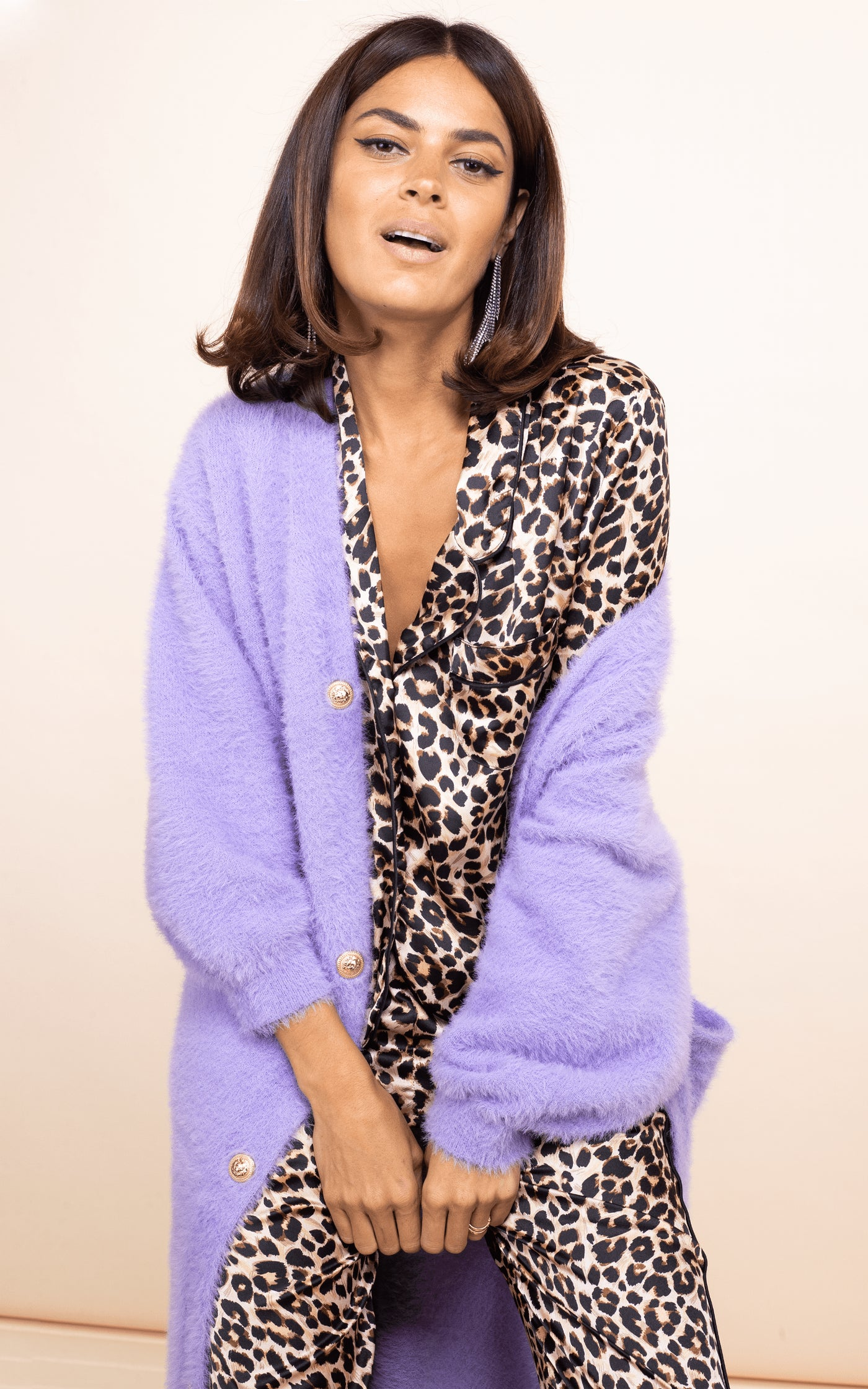 Dancing Leopard model faces forward wearing Enya PJ Set in Rich Leopard print with purple cardigan