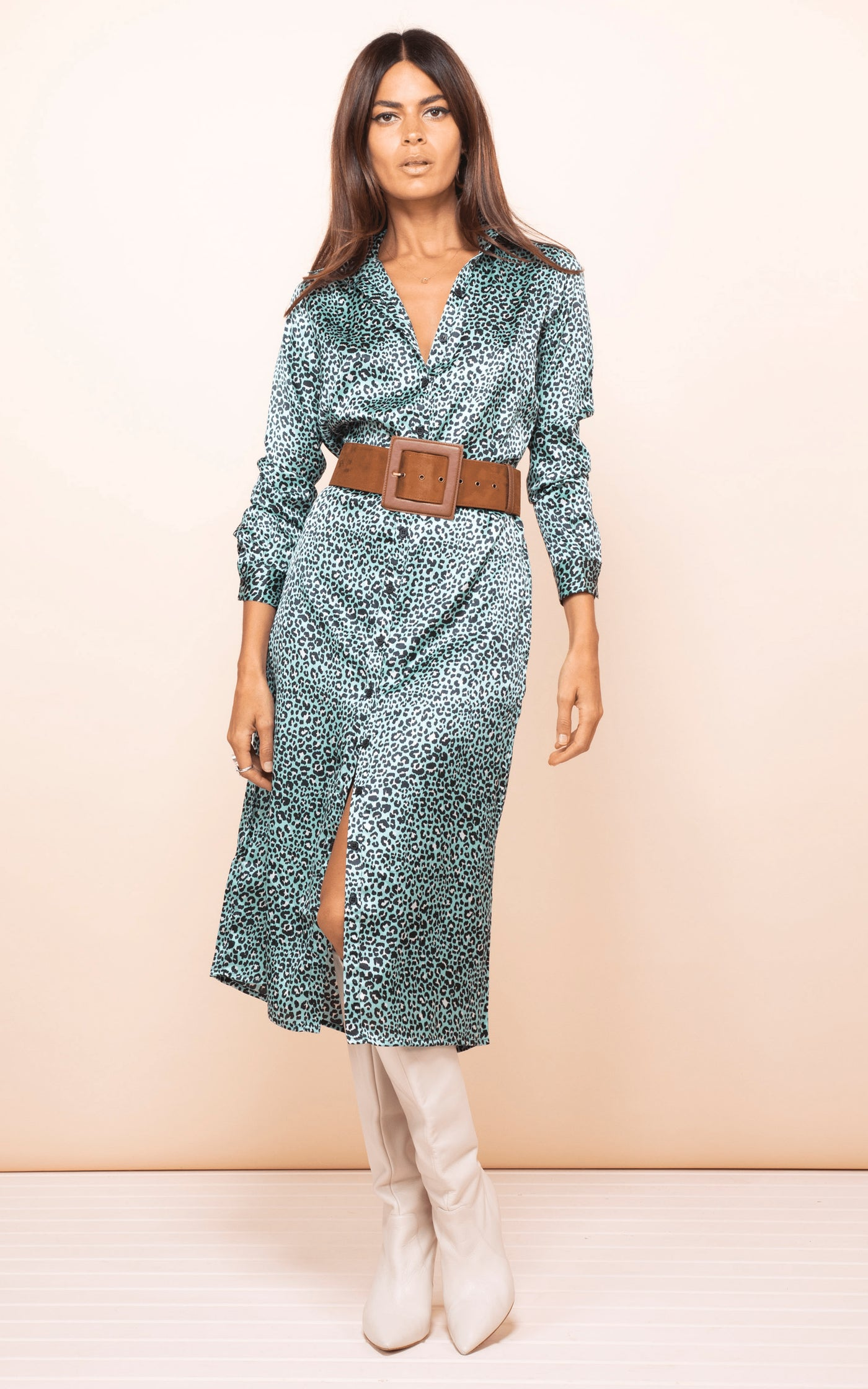 Front-facing model wears Dancing Leopard Hadiba Midi Shirt Dress in mint leopard print with boots