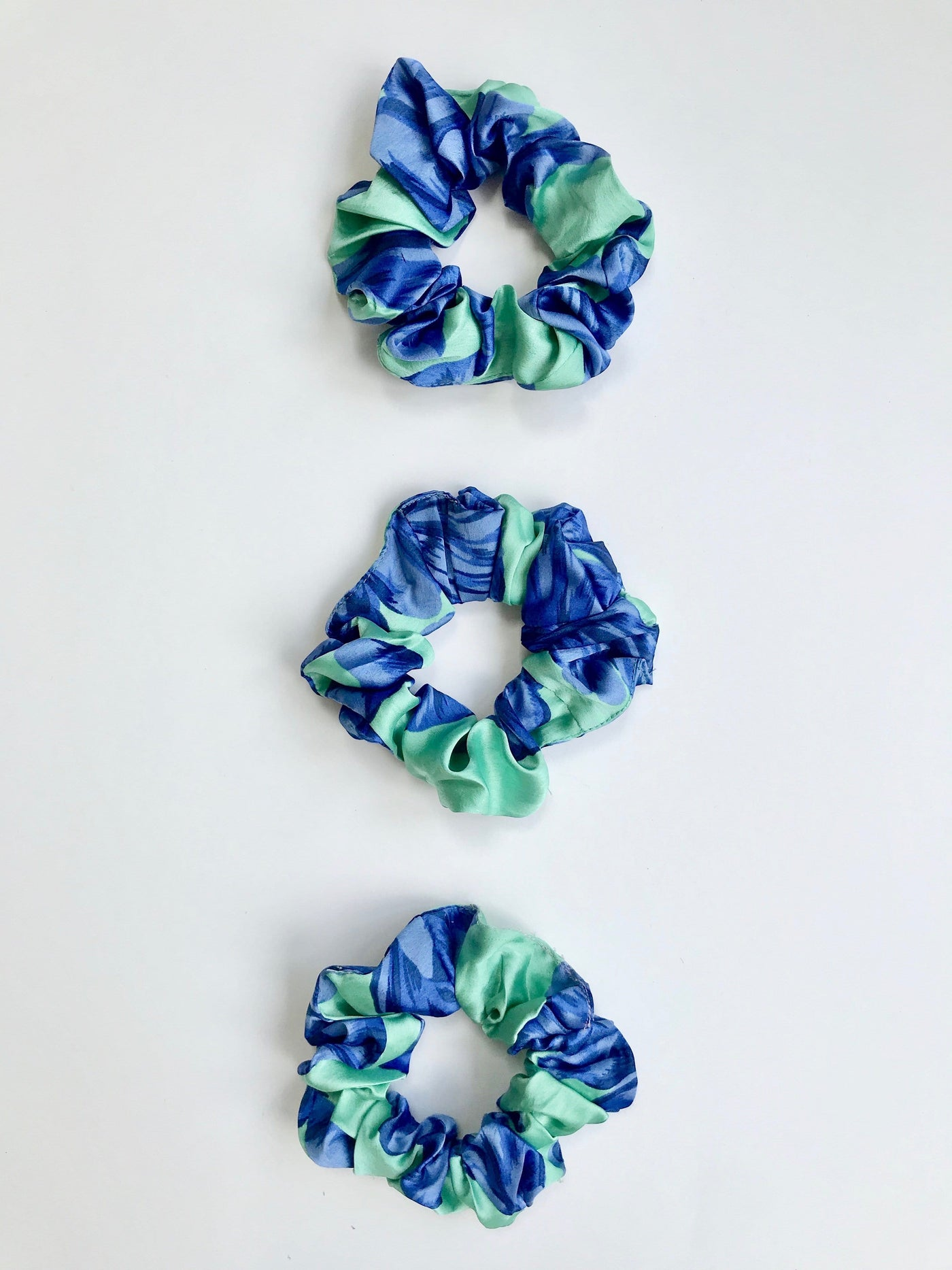 Pack of 3 scrunchies in Pink Mint Bloom print by Dancing Leopard against white backdrop