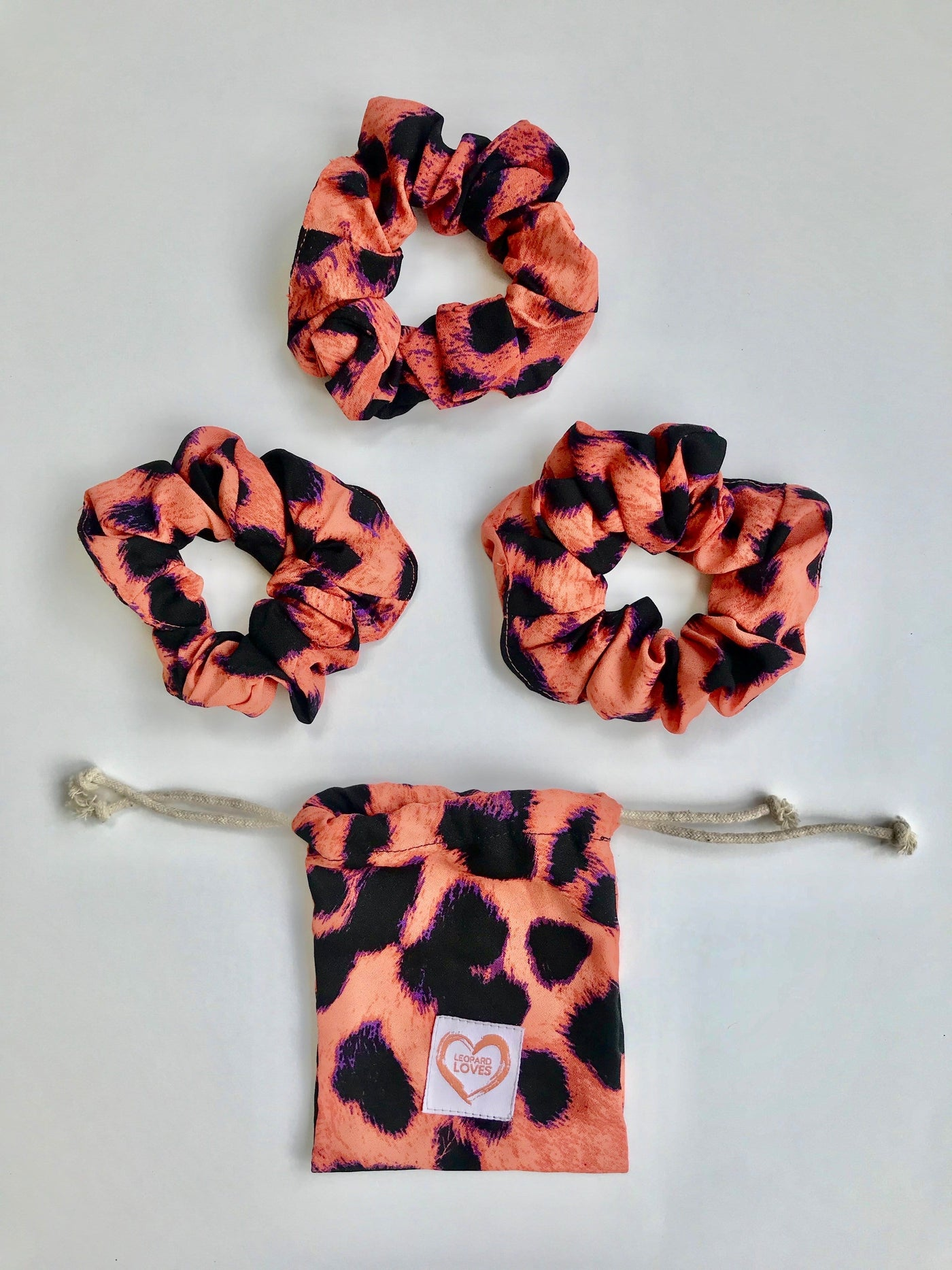 Pack of 3 scrunchies with drawstring bag in Plorange print by Dancing Leopard