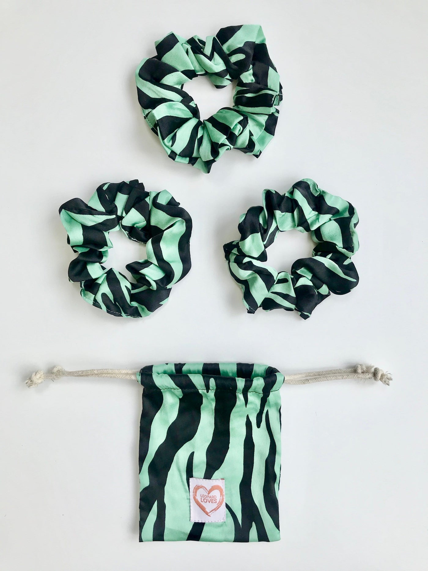 Pack of 3 scrunchies with drawstring bag in Green Zebra print by Dancing Leopard