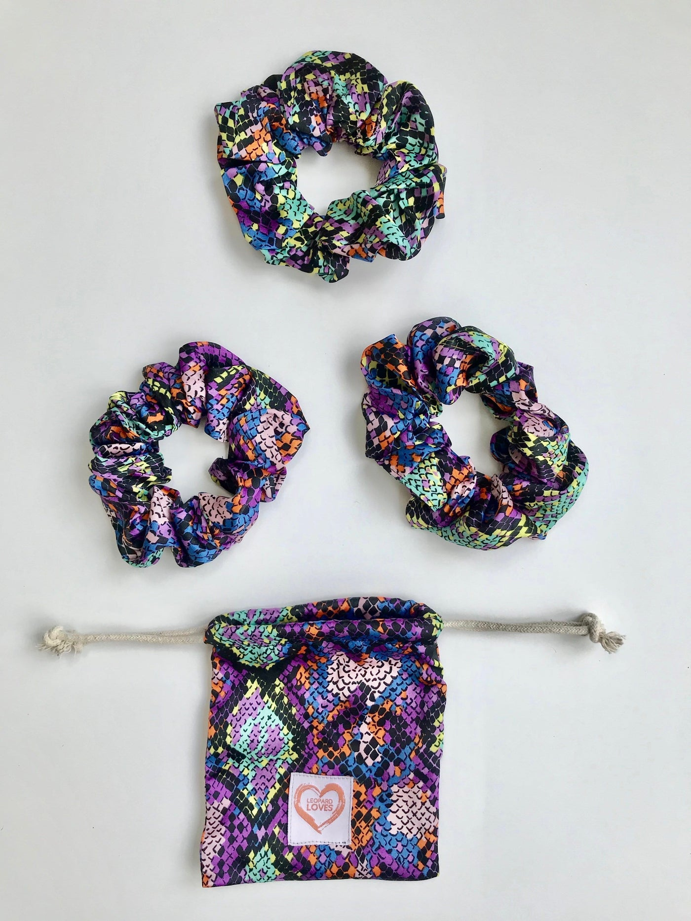 Pack of 3 scrunchies with drawstring bag in Multi Snake print by Dancing Leopard