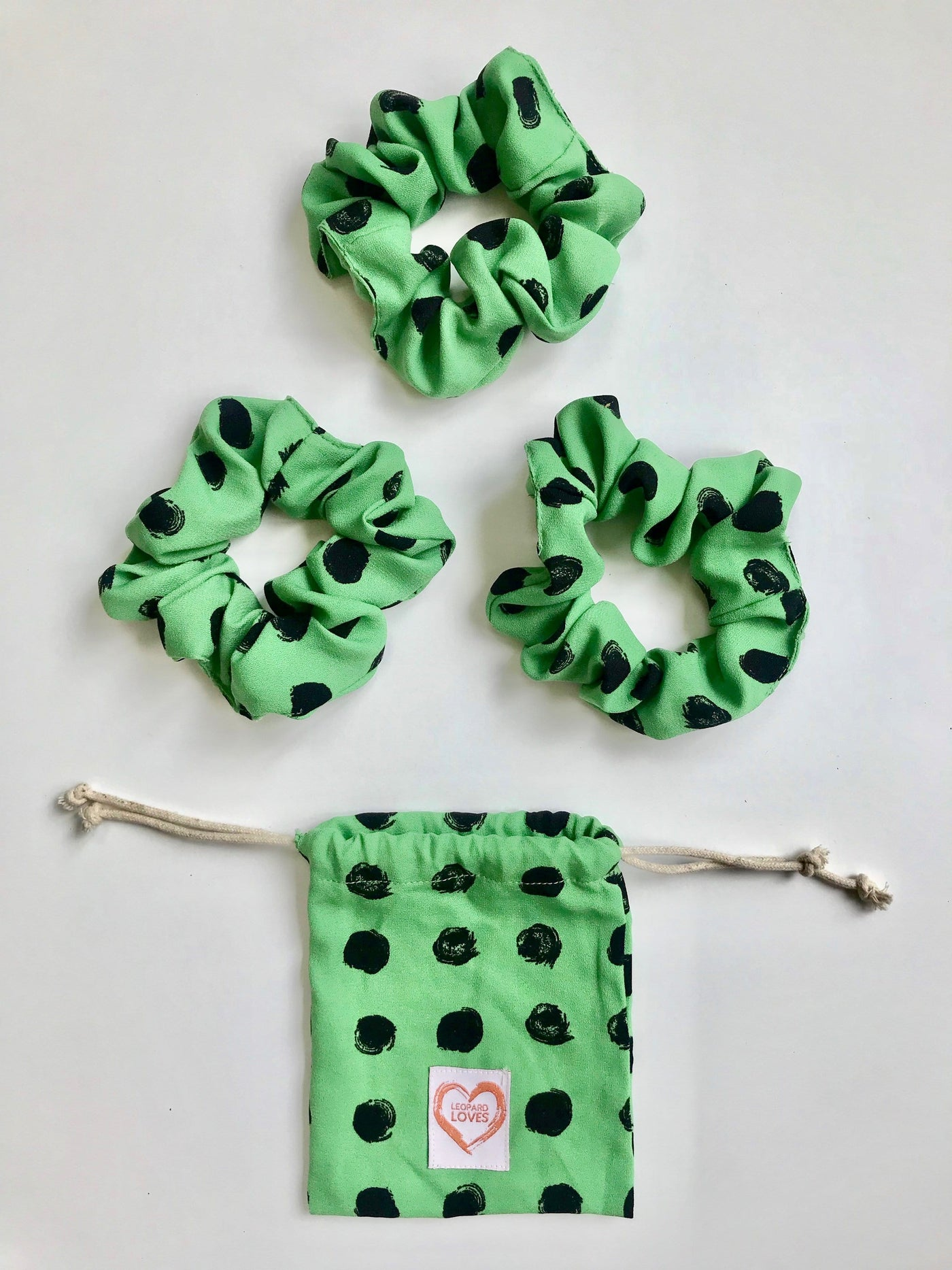 Pack of 3 scrunchies with drawstring bag in Green Dotty print by Dancing Leopard