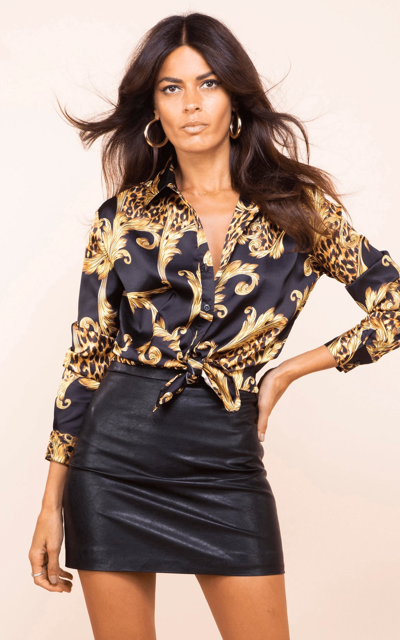 Front-facing model wears Dancing Leopard Nevada Shirt in black baroque print with black PU skirt