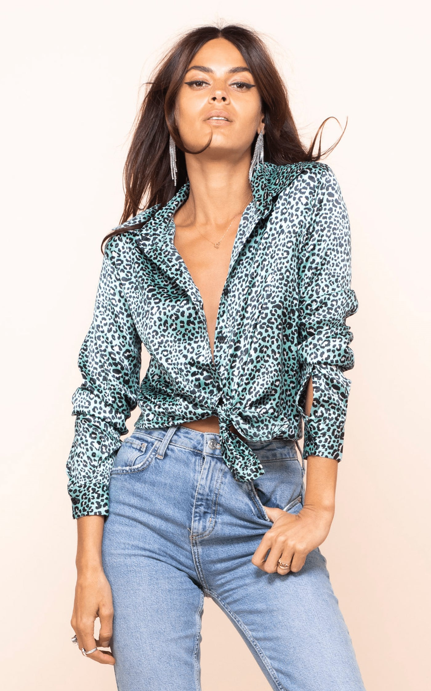 Dancing Leopard model faces forward wearing Nevada Shirt in mint ditzy leopard print with jeans