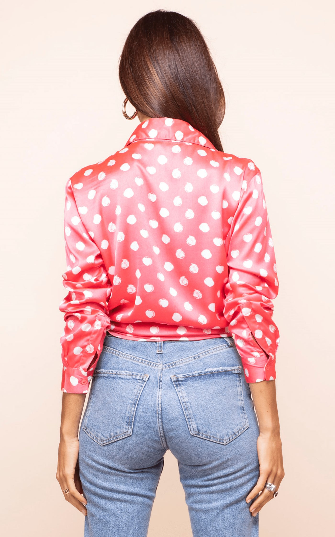 Dancing Leopard model faces backwards wearing Nevada Shirt in red dotty print with jeans