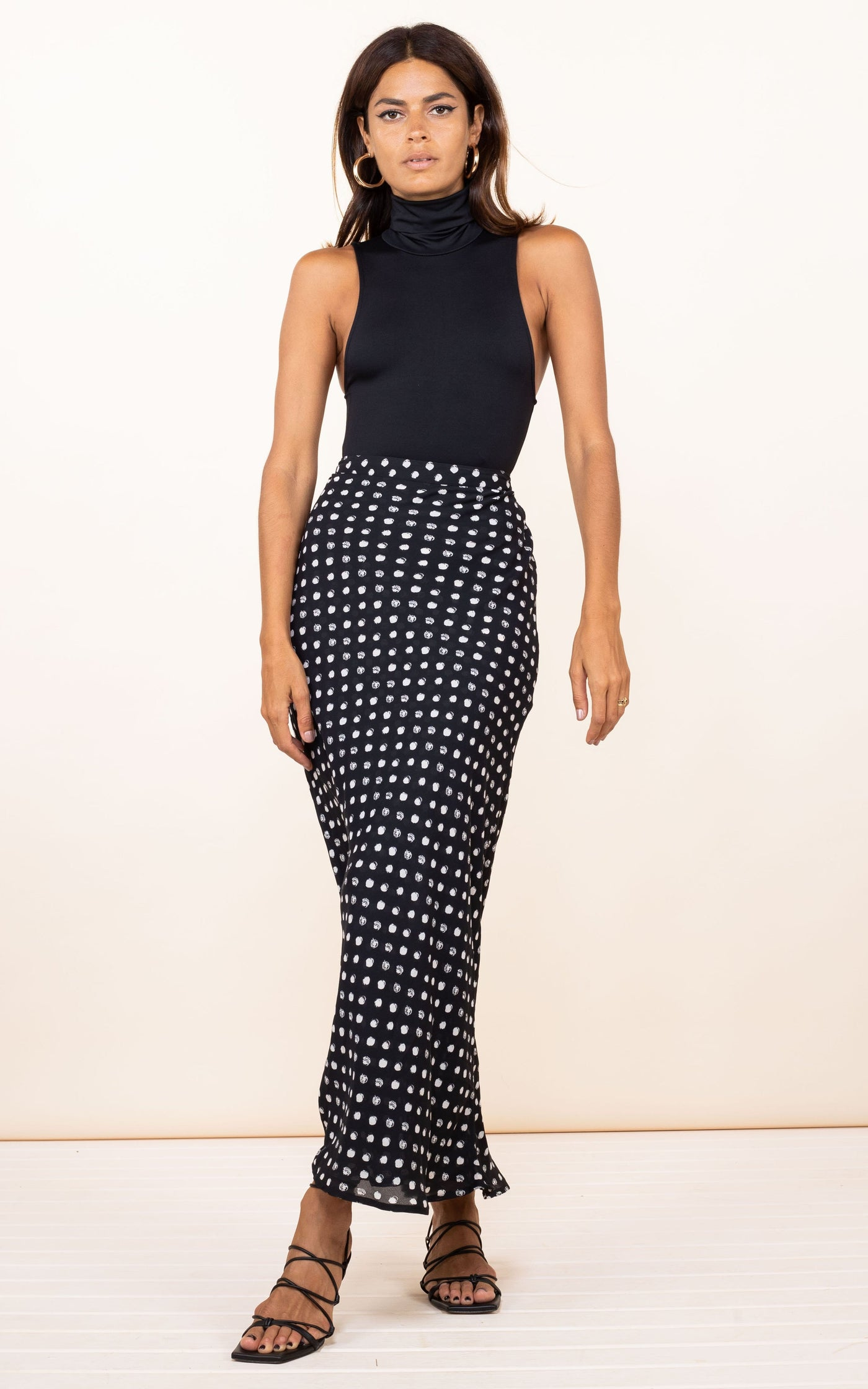 Model faces forward wearing Sophie Skirt in black dotty by Dancing Leopard