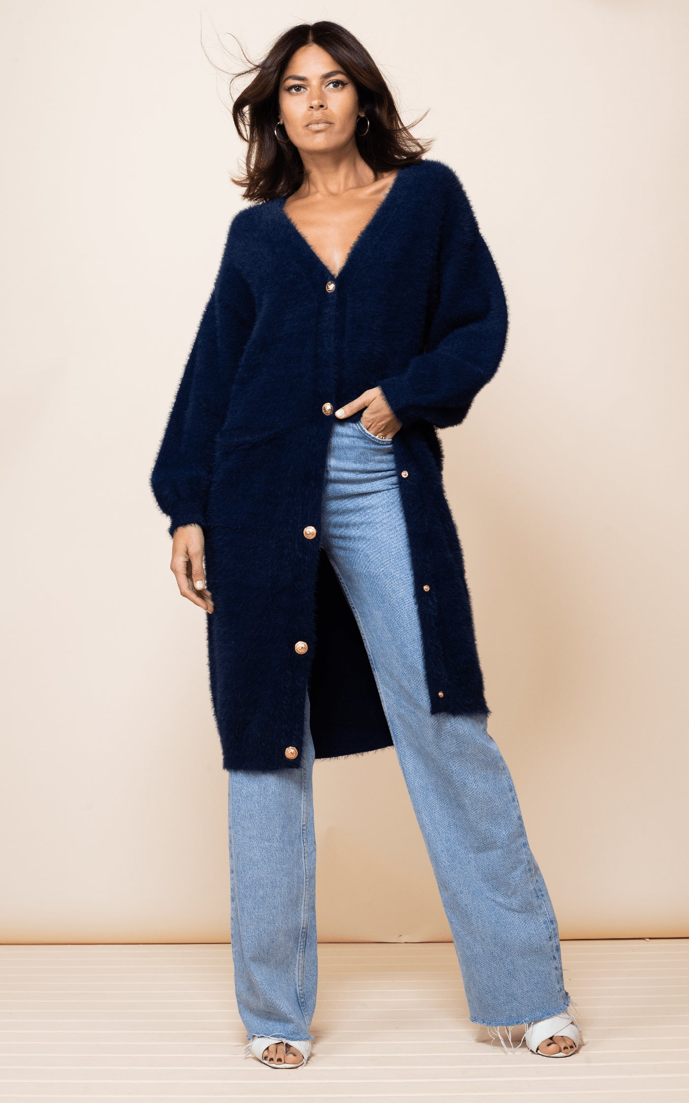 Dancing Leopard model faces forward wearing Taylor Cardigan in Navy with jeans