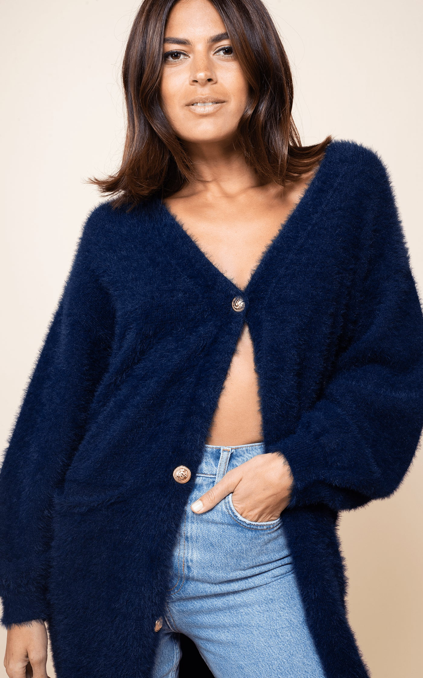 Close-up of Dancing Leopard wearing Taylor Cardigan in Navy with jeans