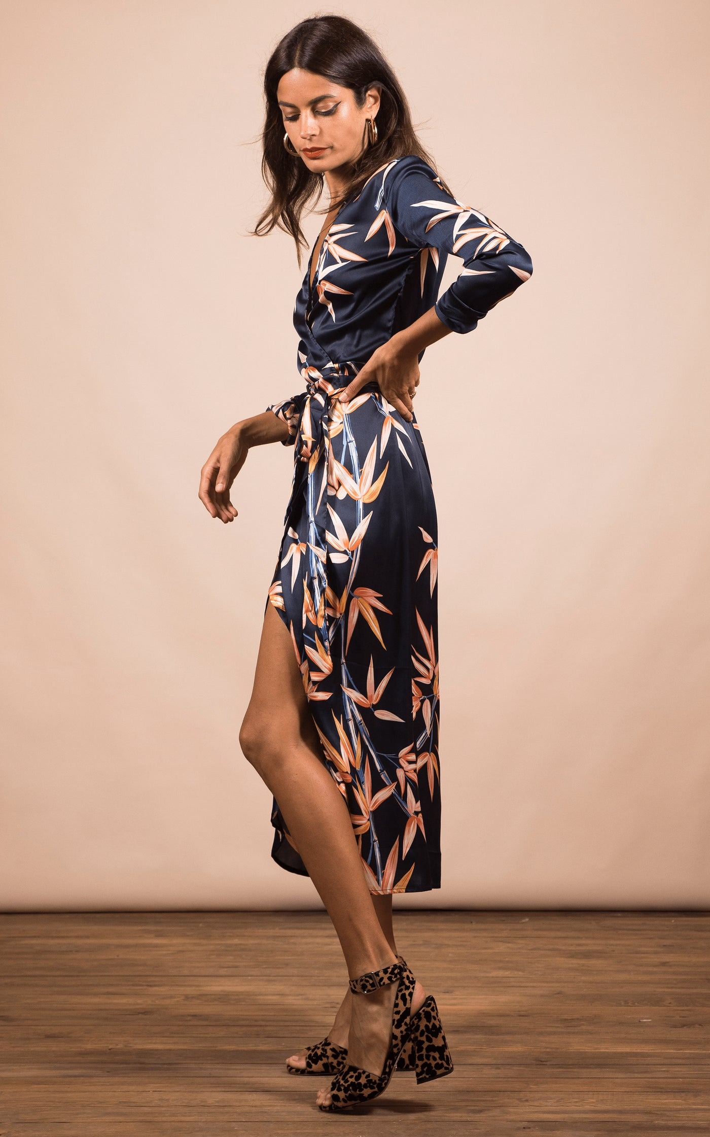 Dancing Leopard model faces sideways wearing Yondal Dress in bamboo print with heels