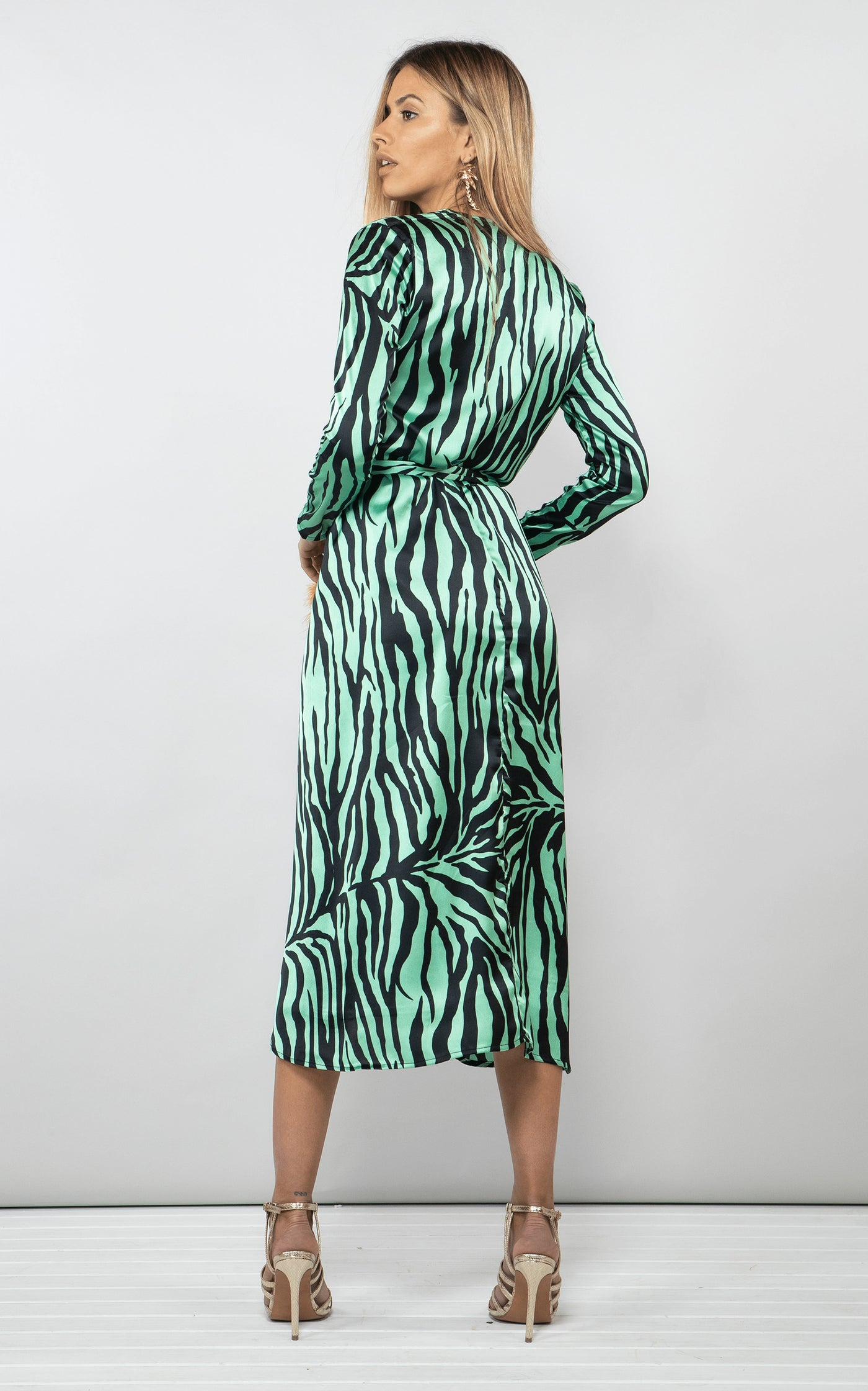 Backward-facing model wears Dancing Leopard Yondal Dress in green zebra print