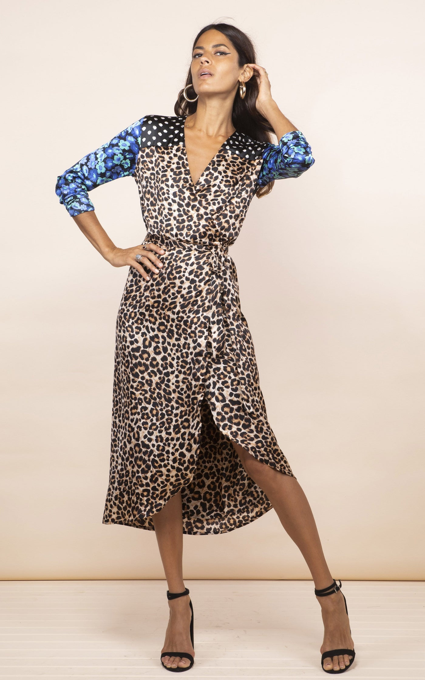 Dancing Leopard model faces forward and leans back wearing Yondal Dress in leopard-floral print