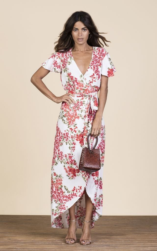 Forward-facing model wears Cayenne Dress in floral blossom print by Dancing Leopard