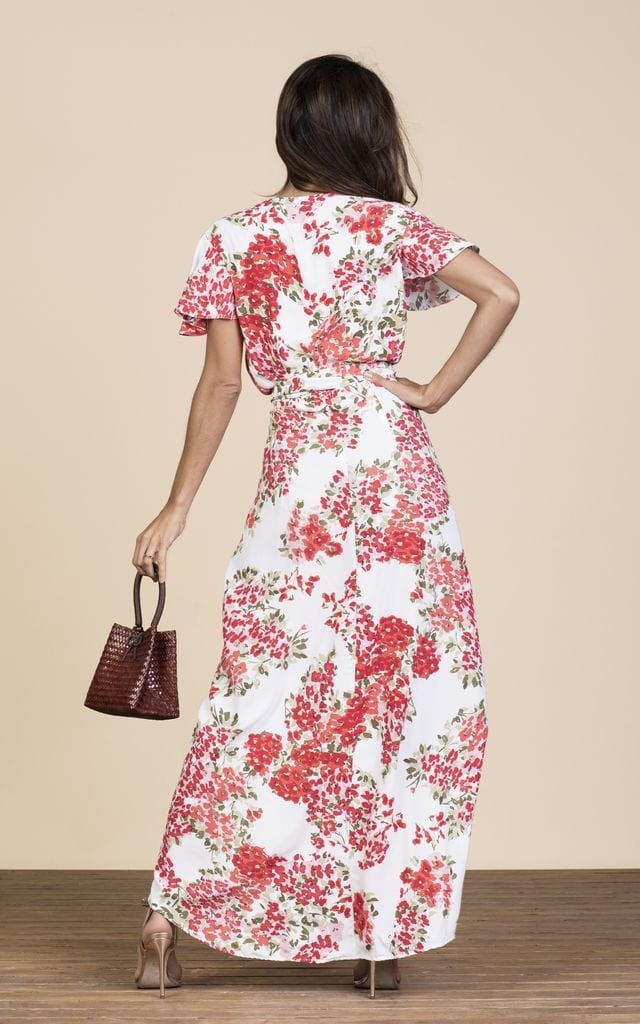 Backward-facing brunette model wears Cayenne Dress in floral blossom print