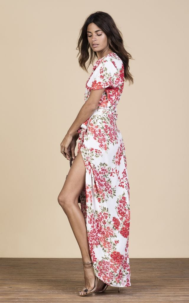 Dancing Leopard sideways-facing model wears Cayenne Dress in white and pink blossom floral print
