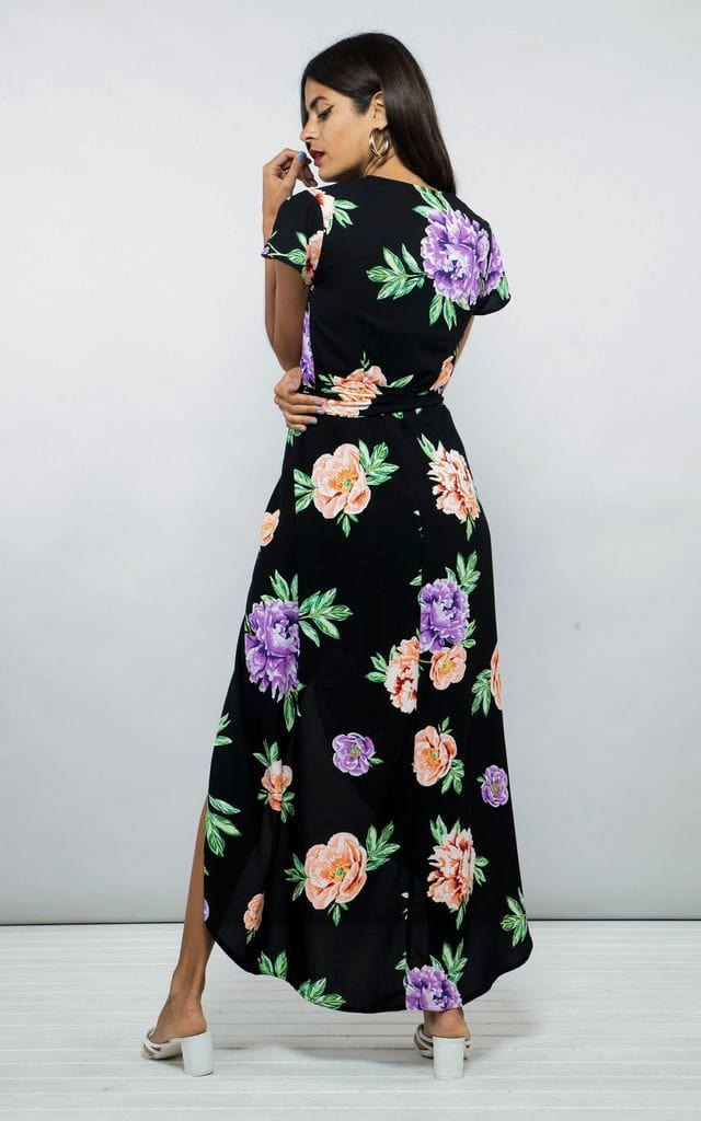 Backward-facing model wears Cayenne Dress in black and multi peony floral print by Dancing Leopard