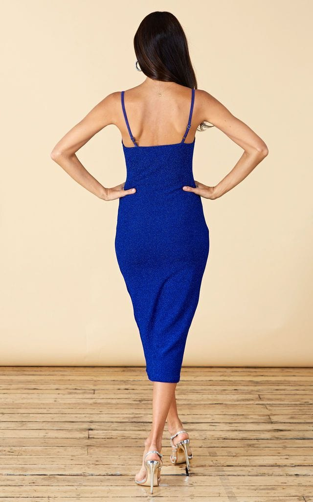 Backward-facing model wears Cici Midi Cami Dress in Blue Sparkle fabric by Dancing Leopard