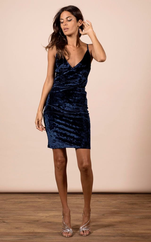 Front-facing model with arm up wears Cici Mini Cami Dress in navy velvet fabric